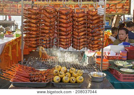 KOTA KNABALU MALAYSIA - AUGUST 1 2017: Grilled chicken wings chicken tails and corn at street market Kota kinabalu city.