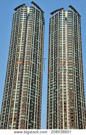 High density residential building in Hong Kong with blue sky background.