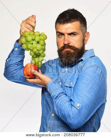 Farmer Shows His Harvest. Winegrower With Serious Face