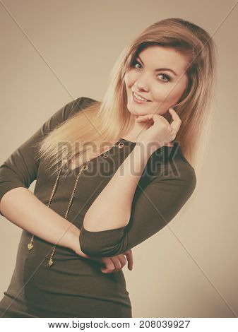 Attractive Blonde Woman Wearing Tight Green Khaki Top