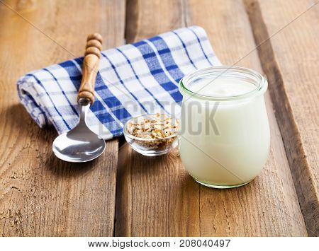 natural glass yoghurt on a wooden background