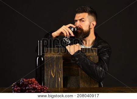 Winetasting And Degustation Concept. Man With Beard Holds Wineglass