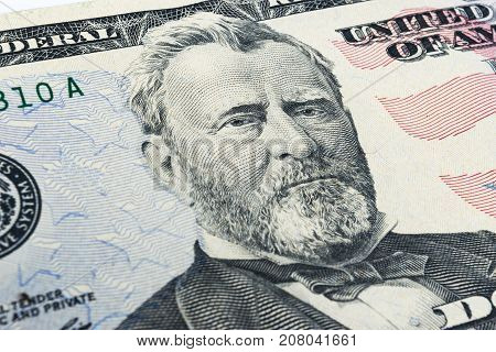 Ulysses S. Grant face on US fifty or 50 dollars bill macro united states money closeup. Heap of 50 hundred dollar bills on money background.