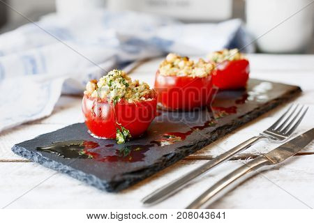 Tomato stuffed with cous cous. Vegetarian healthy food