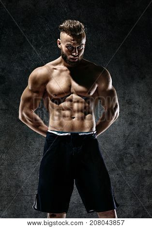 Sporty muscular man shirtless. Photo of man with perfect body after training. Strength and motivation