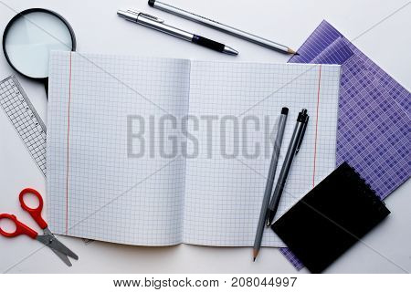 School and office supplies on a white background. View from above