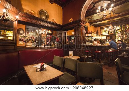 BRUSSELS BELGIUM - JUNE 18 2016: An indoor picture of a traditional pub in Brussels old town with a warm tone. Brussels Belgium.