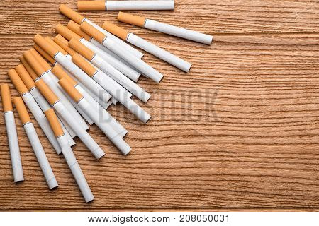 cigarette, cigarette on a wooden background, a pack of cigarettes, a close-up of a cigarette