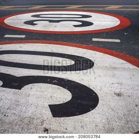 Limits do not drive speed cars 30 kilometers per Hours painted on the street.