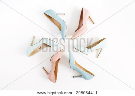 Fashion blog look. Pastel colorful women high heel shoes on white background. Flat lay top view trendy beauty female background.