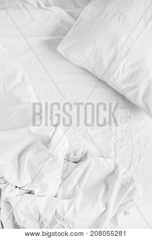 Flat lay of white linen. Top view minimal bed concept.
