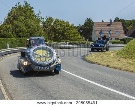Sainte Marguerite sur Mer France - July 09 2015: Festina Caravan during the passing of Publicity Caravan before the stage 6 of Le Tour de France 2015 on 09 July 2015. Festina is a very old and famous company which produces high quality watches.