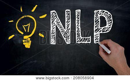 NLP is written by hand on blackboard.