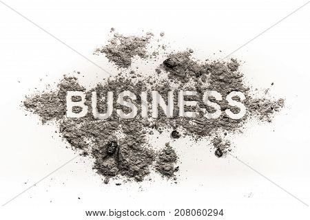 Business word in dirt ash sand as a economy or financial criminal dirty money concept and fail trade background