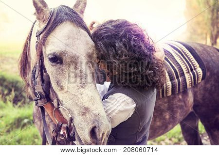 Horsewoman Embraces His Horse With Affection