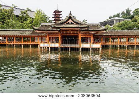 Japanese temple - Itsukushima shrine with reflection in the sea and five-story-temple - Miyajima, Hiroshima, Japan