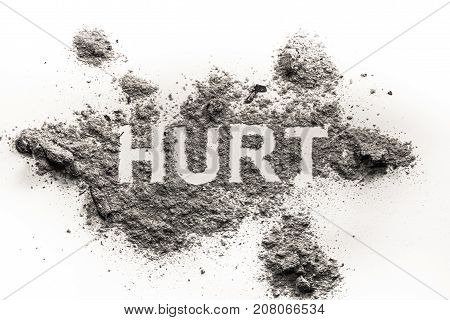 Hurt word as physical or emotional pain ache sickness health concept written in pile of dust ash sand