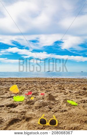 child toys in the sand on the beach. Relaxation or vacation concept.