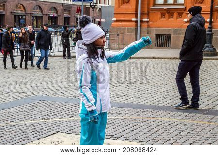 Making Wishes At The Zero Kilometer On The Red Square.