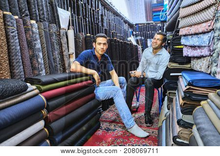 Fars Province Shiraz Iran - 19 april 2017: Portrait of two Iranian owners of the textile department at the city market.