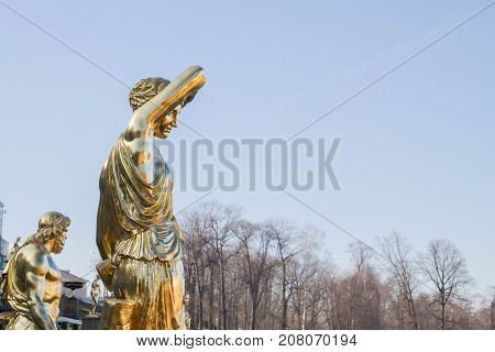 The Golden Sculpture In The Park Of Fountains In The City Of Peterhof