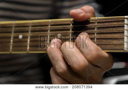 acoustic guitar close-up playing chord for jazz rock music