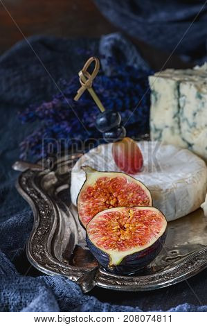 Half of ripe figs with Gorgonzola and Camembert. Close-up. Village. The horizontal frame.
