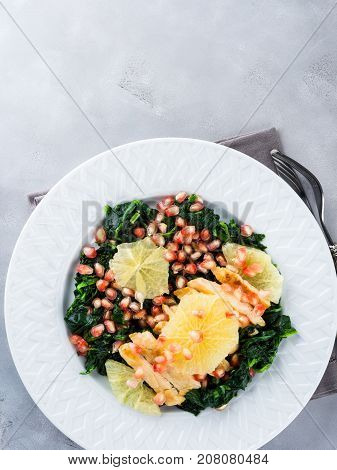 Chicken breast salad with spinach, white pomegranate and grapefruit. Light lunch. Festive winter meal