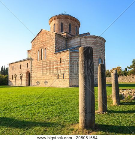PITSUNDA ABKHAZIA SEPTEMBER 19 2017: Ancient Patriarchal Cathedral in honor of the Apostle Andrew in Pitsunda in warm summer day