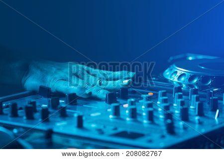Dj, Disk Jockey Mixing Music With Blue Light