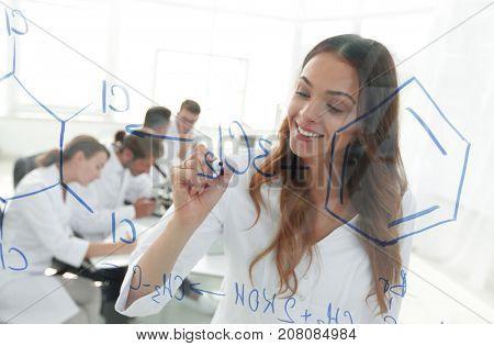 female,white robe,writing,laboratory,Caucasian