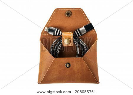 Usb Cable In A Leather Rectangular Envelope On A White Isolated Background