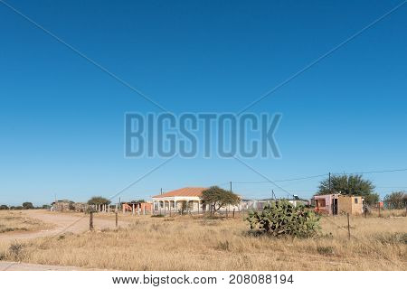 SCHMIDTSDRIFT SOUTH AFRICA - JULY 7 2017: Street scene with houses and shacks in Schmidtsfrift in the Northern Cape Province of South Africa