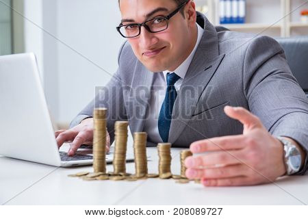 Man with coins in the office
