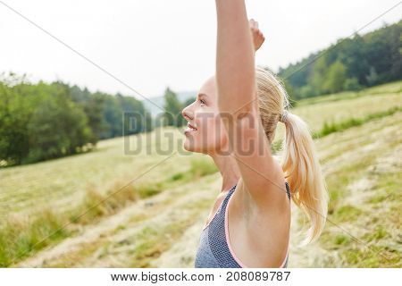 Woman breathing deeply as yoga exercise in the nature