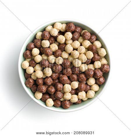 Breakfast cereal balls in bowl. Tasty breakfast. Chocolate cereals.