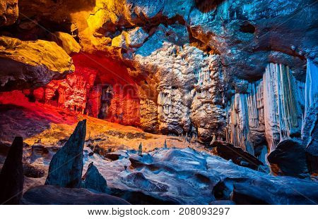 Cango Cave, amazing view on stalactites in colorful bright light, beautiful natural attraction, wonderful nature, touristic place, historical landmark, South Africa