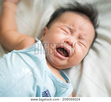 Asian baby cry from hungry need a milk and alone without mom.
