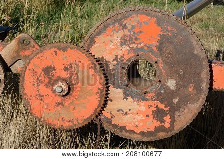 Rusted gears on old vintage agricultural machinery
