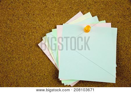 A Yellow Sticky Note Writing, Caption, Inscription Colorful Sticky Notes On Cork Bulletin Board