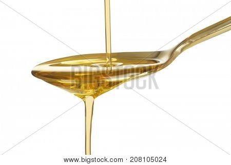 Pouring cooking oil into spoon on white background