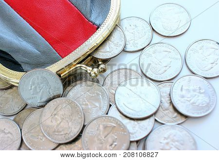American dollars in a coin purse on a white background. Close-up. The concept of saving money in crisis and home finance, savings.