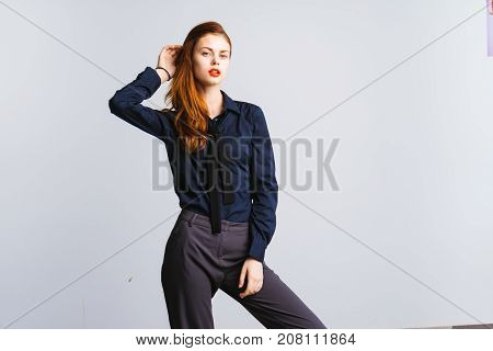 girl secretary in a black shirt posing on a white background