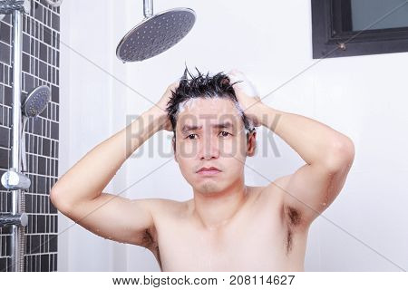 Unhappy Man Are Taking A Rain Shower And Washing Hair In Bathroom