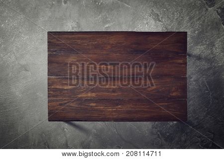 Wooden table on a concrete background