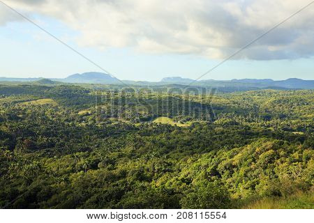 view from Bakunayagua bridge to palms valley and mountains at the horizon Cuba