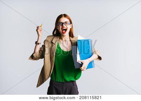 young secretary girl smiling holding a folder