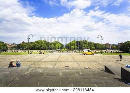 BRUSSELS BELGIUM - JUNE 19 2016: View from the steps of Basilica of the Sacred Heart in Koekelberg facing the Elisabeth Park in a sunny day with clouds. Brussels Belgium.