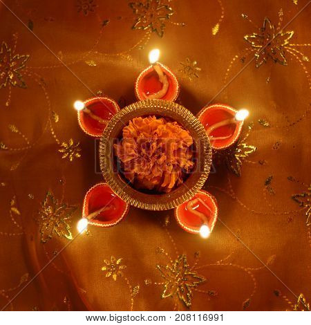 A top angle of a traditional Indian earthen lamp - Deepavali greeting card cover