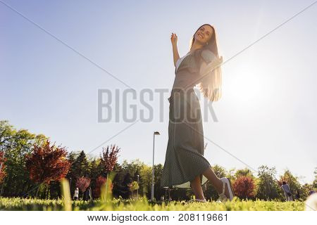 Joyful and happy woman outdoor, raised arms ,freedom summer